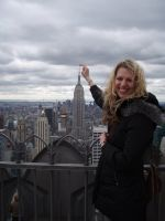 Me pretending to be a giant woman on top of a tall building in New York.